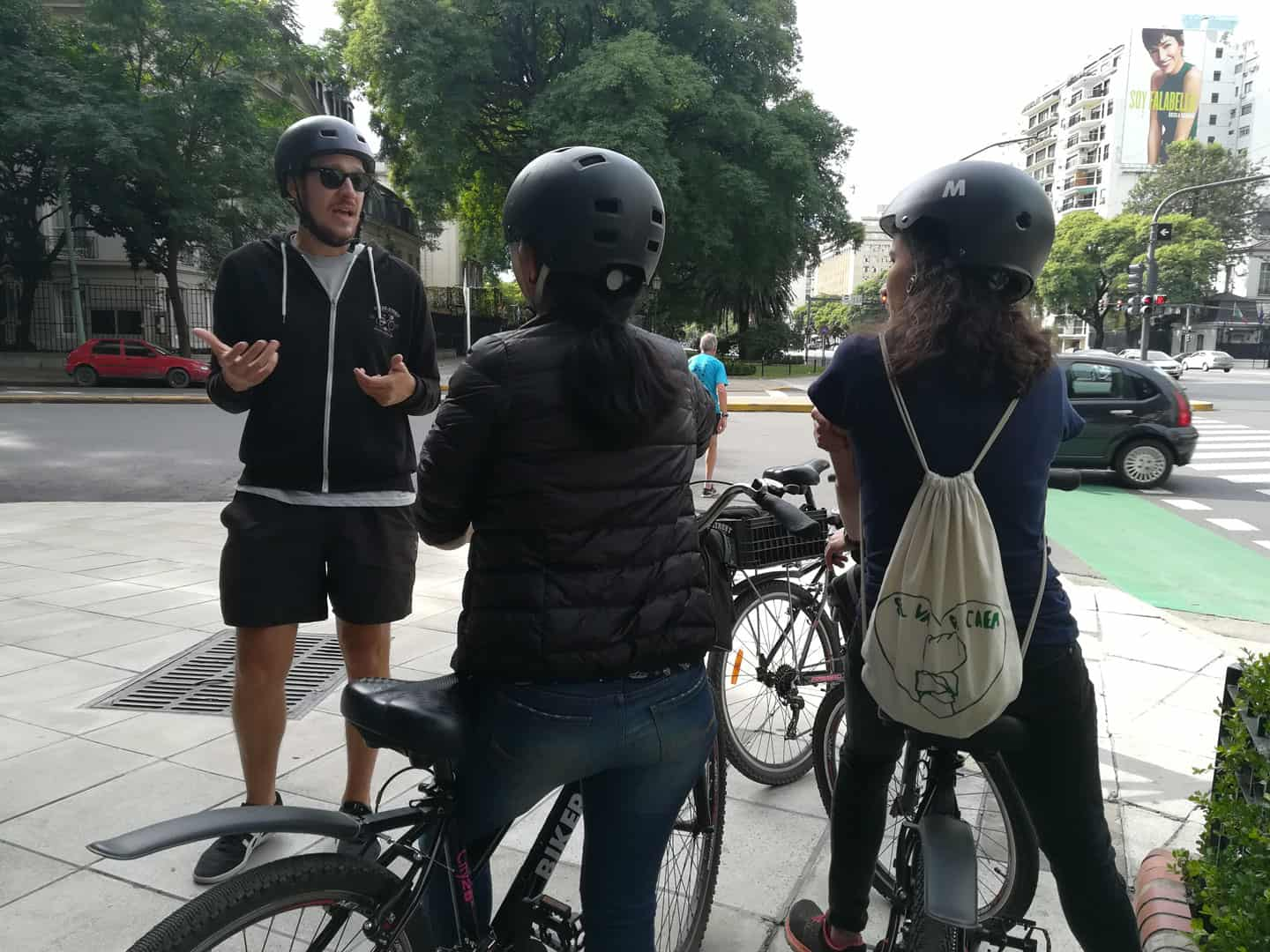 Girl wearing a small backpack during a Bike Tour in Buenos Aires