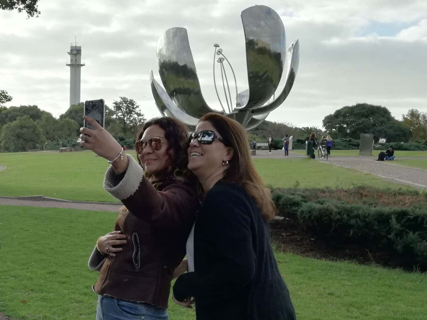 Taking a selfie at Floralis Generica Park during a Bike Tour