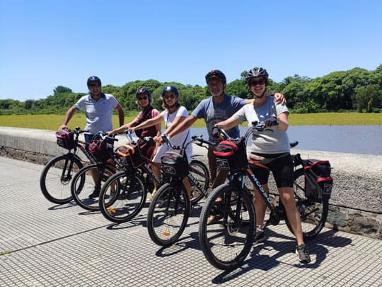picture in front of Reserva Ecologica in Buenos aires riding a bike