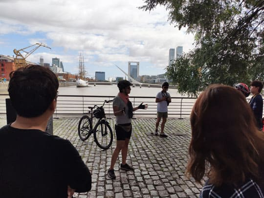 Gilda explaning about puerto madero area during the bike tour